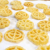 Members of the Polish Cultural Committee along with volunteers were cooking up some rosettes on Wednesday to have at the Lowell Folk Festival.  Rosettes are a form of Polish fried dough known as Chrusts. SUN/JOHN LOVE