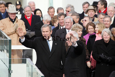 President George W Bush and Vice Presidnet Dick Cheney wave post Inaguration Swear In