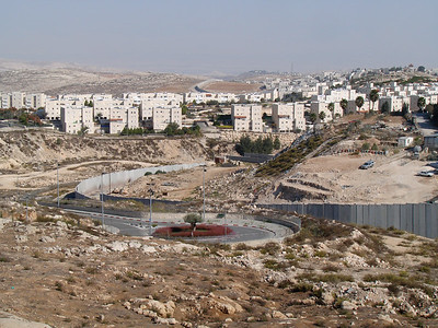 Shuafat Refugee Camp is on the east side of the Separation Fence, to the right. The buildings in the background are part of the Israeli settlement Pisgat Ze'ev.