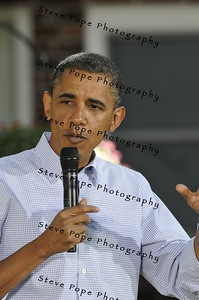 U.S. President Barack Obama speaks in the backyard of a home in the Beaverdale section of Des Moines, Iowa.