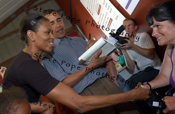 U.S. Senator, and Democratic presidential candidate Barack Obama, and his wife Michelle Obama, sign autographs and greet potential supporters during a family visit to the Iowa State Fair, Thursday August 16, 2007 in Des Moines, Iowa.