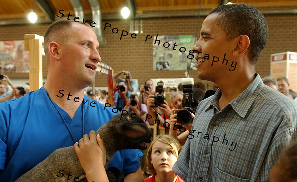 U.S. Senator, and Democratic presidential candidate Barack Obama talks with a staff member, of the new Animal Learning Center, while spending time at the Iowa State Fair, Thursday August 16, 2007 in Des Moines, Iowa.