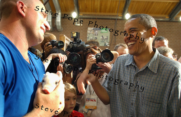 U.S. Senator, and Democratic presidential candidate Barack Obama has a good laugh while touring the new Animal Learning Center, as he and his family spent time at the Iowa State Fair, Thursday August 16, 2007 in Des Moines, Iowa.