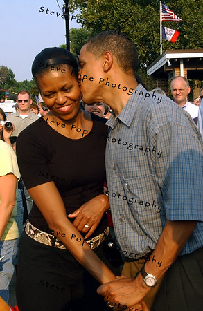 U.S. Senator, and Democratic presidential candidate Barack Obama kisses his wife Michelle Obama, as they and their  daughters, spend time on the grounds of the Iowa State Fair, Thursday August 16, 2007 in Des Moines, Iowa.