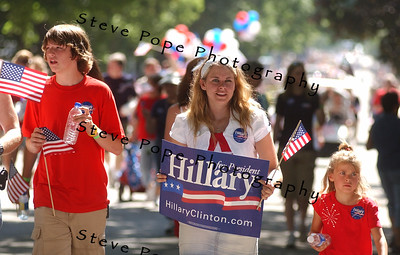 Supporters of Senator and Democratic presidential hopeful Hillary Clinton, and her husband, former president Bill Clinton, follow the couple in the Independence Day Parade  in Clear Lake, Iowa, 4 July, 2007.