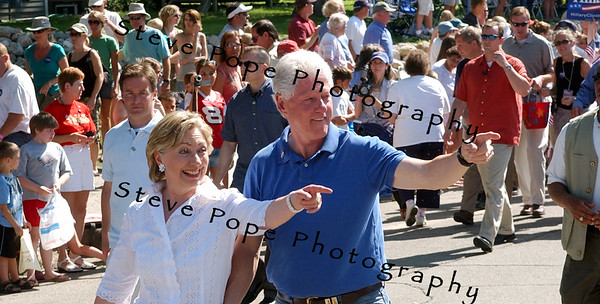 Senator and Democratic presidential hopeful Hillary Clilnton and her husband, fromer president Bill Clinton march in the Independence Day Parade  in Clear Lake, Iowa, 4 July, 2007.