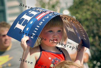 A young Clinton supporter waits along the route for Senator and Democratic presidential hopeful Hillary Clinton, and her husband, former president Bill Clinton fans, who marched  in the Independence Day Parade  in Clear Lake, Iowa, 4 July, 2007.