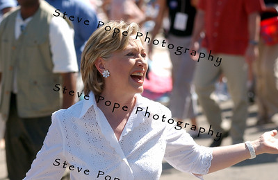 Senator and Democratic presidential hopeful Hillary Clinton, and her husband, former president Bill Clinton, march in the Independence Day Parade  in Clear Lake, Iowa, 4 July, 2007.