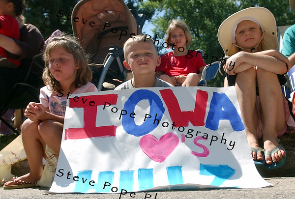 Young Clinton supporters wait along the route for Senator and Democratic presidential hopeful Hillary Clinton, and her husband, former president Bill Clinton fans, who marched  in the Independence Day Parade  in Clear Lake, Iowa, 4 July, 2007.