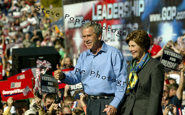 President George W. Bush speaks at a rally in Waterloo, Iowa Saturday Oct. 10, 2004. The day after the second of three debates with Sen. John Kerry the Democratic opponent, Bush was back on the campaign trail. (EPA/POOL PHOTO)