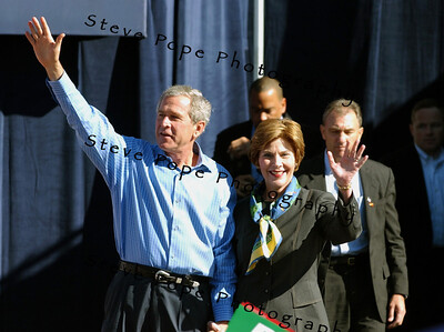 President George W. Bush and first lady Laura Bush greet supporters as the arrive at a rally in Waterloo, Iowa Saturday Oct. 10, 2004. The day after the second of three debates with Sen. John Kerry the Democratic opponent, Bush was back on the campaign trail. (EPA/Steve Pope)
