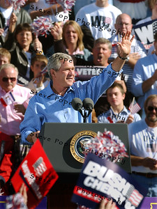 President George W. Bush waves after speaking at a rally in Waterloo, Iowa Saturday Oct. 10, 2004. The day after the second of three debates with Sen. John Kerry the Democratic opponent, Bush was back on the campaign trail. (EPA/Steve Pope)