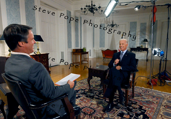 U.S.  Vice-president Joe Biden greets ABC's Terry Moran on a make-shift set in the Hotel Fort Des Moines, prior to Moran's interview, Tuesday Oct. 12, 2010 in Des Moines, Iowa. (AP Photo/Steve Pope)