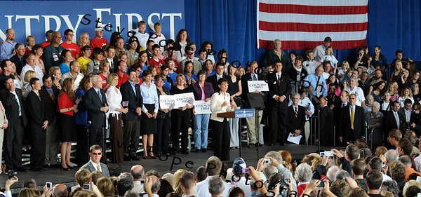 Republican Vice Presidential Candidate Sarah Palin greets supporters at a Victory Rally, 18 September, 2008 in Cedar Rapids, Iowa. Presidential candidate John McCain listens at the left.