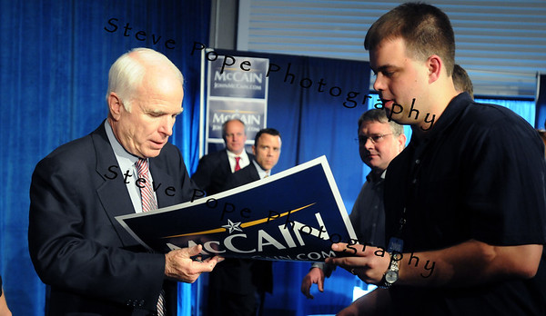 U.S. Republican Senator and presidential hopeful John McCain signs an autograph after speaking at a Town Hall meeting in Des Moines, Iowa, USA, 1 May, 2008.