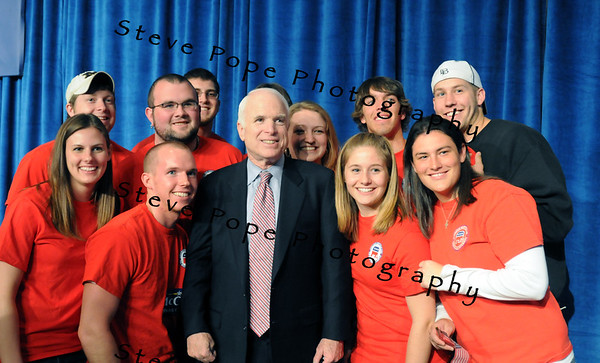 U.S. Republican Senator and presidential hopeful John McCain poses for a photo with a group of college students after speaking at a Town Hall meeting in Des Moines, Iowa, USA, 1 May, 2008.