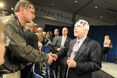 U.S. Republican Senator and presidential hopeful John McCain shakes hands with Chris Charron after speaking at a Town Hall meeting in Des Moines, Iowa, USA, 1 May, 2008.
