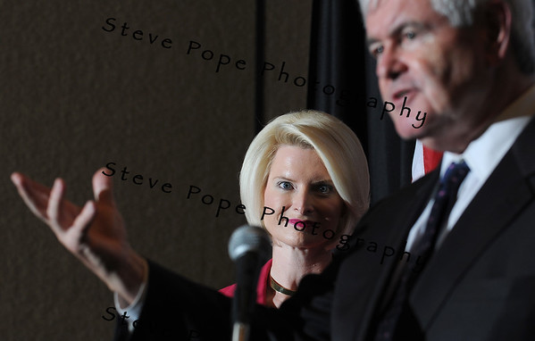 Callista Gingrich, wife of former House speaker and Republican Presidential candidate, Newt Gingrich, listens to her husband speak to a group of Iowans at the Embassy Suite Hotel, Monday May 16, 2011. It was Gingrich's third of 17 stops planned across Iowa the next 6 days after announcing last week that he is seeking the Republican nomination for president. (Steve Pope/Photo)