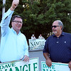 State Rep. Dave Nangle, D-Lowell, and Vanna Howard, one of two challengers in the Democratic primary for the 17th Middlesex district, stand with their respective supporters outside the Reilly Elementary School polling place. Dave Nangle, left, thanks a supporter. At right is Paul Dubuque of Lowell. (SUN/Julia Malakie)