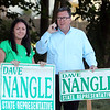 State Rep. Dave Nangle, D-Lowell, and Vanna Howard, one of two challengers in the Democratic primary for the 17th Middlesex district, stand with their respective supporters outside the Reilly Elementary School polling place. Dave Nangle with daughter Kellie Nangle. (SUN/Julia Malakie)