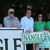State Rep. Dave Nangle, D-Lowell, and Vanna Howard, one of two challengers in the Democratic primary for the 17th Middlesex district, stand with their respective supporters outside the Reilly Elementary School polling place. From left, Terry Downes, Nangle's brother Bill Nangle, State Rep. Dave Nangle, his daughter Kellie Nangle, and his girlfriend Donna Rignoli, all of Lowell.   (SUN/Julia Malakie)