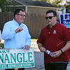 State Rep. Dave Nangle, D-Lowell, and Vanna Howard, one of two challengers in the Democratic primary for the 17th Middlesex district, stand with their respective supporters outside the Reilly Elementary School polling place. Dave Nangle, left, talks to supporter Derek Heartquist of Lowell.(SUN/Julia Malakie)
