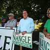 State Rep. Dave Nangle, D-Lowell, and Vanna Howard, one of two challengers in the Democratic primary for the 17th Middlesex district, stand with their respective supporters outside the Reilly Elementary School polling place. From left, Tom Scanlon, Annie O'Connor (a cousin of Nangle), Terry Downes, Nangle's brother Bill Nangle, Dave Nangle and his girlfriend Donna Rignoli. (SUN/Julia Malakie)