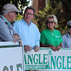State Rep. Dave Nangle, D-Lowell, and Vanna Howard, one of two challengers in the Democratic primary for the 17th Middlesex district, stand with their respective supporters outside the Reilly Elementary School polling place. From left, Nangle's brother Bill Nangle, State Rep. Dave Nangle and his girlfriend Donna Rignoli, and Joan Lenzi, all of Lowell.   (SUN/Julia Malakie)