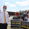 Candidate for reelection to the Billerica Select Board Andrew Deslaurier, outside the Hajjar School polling place, with supporters Eileen Cole, a retired teacher at Hajjar, and Kristin Riley, a current teacher.  JULIA MALAKIE/LOWELLSUN