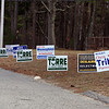 Signs for Billerica town elections on the driveway to the Hajjar School.  JULIA MALAKIE/LOWELLSUN