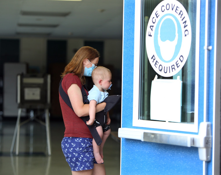 Billerica Town Election.  Arielle Zern, holding son Cody Flint, 13 months old, checks in to vote at Marshall Middle School. It was Cody's second election, since they voted in the presidential primary. (SUN/Julia Malakie)