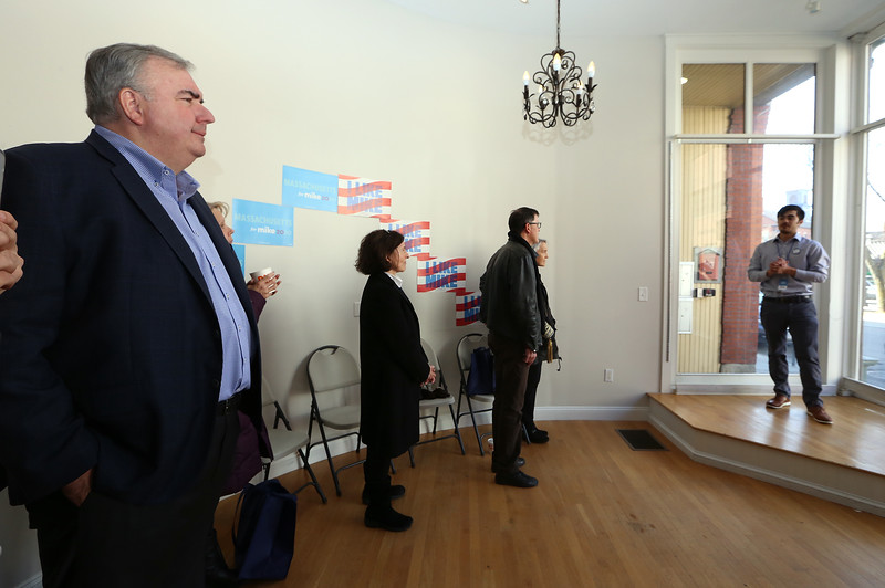Former Lowell Police chief and Boston Police commissioner Ed Davis, left, listens as Kevin Oyakawa, regional field director for Lowell for the Bloomberg campaign, speaks at the opening of the Lowell office of Mike Bloomberg's presidential campaign. (SUN/Julia Malakie)
