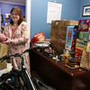 State Rep. Colleen Garry at her district office in Dracut, where she's been collecting puzzles and donated books for seniors, and snacks for the Lavender Cart at Lowell General Hospital.  (Next load of snacks will be the fourth SUV-ful.) The state legislature's expected first remote vote did not happen, due to objections. She's also got a new bicycle. (SUN/Julia Malakie)