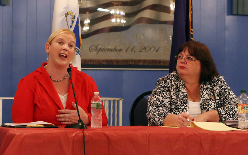 State Rep. Colleen Garry, right, and challenger, Dracut School Committee member Sabrina Heisey, debate at Dracut American Legion. (SUN/Julia Malakie)