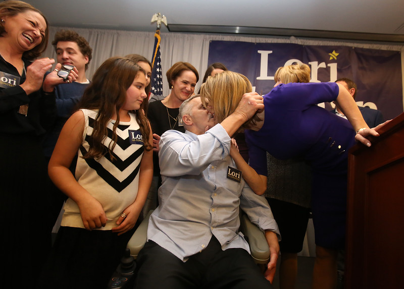 Lori Trahan wins 3rd Congressional District seat. Lori Trahan kisses her father Tony Loureiro. Girl in stripes is her niece Ellie D'Amico, 8, of Andover. (SUN/Julia Malakie)