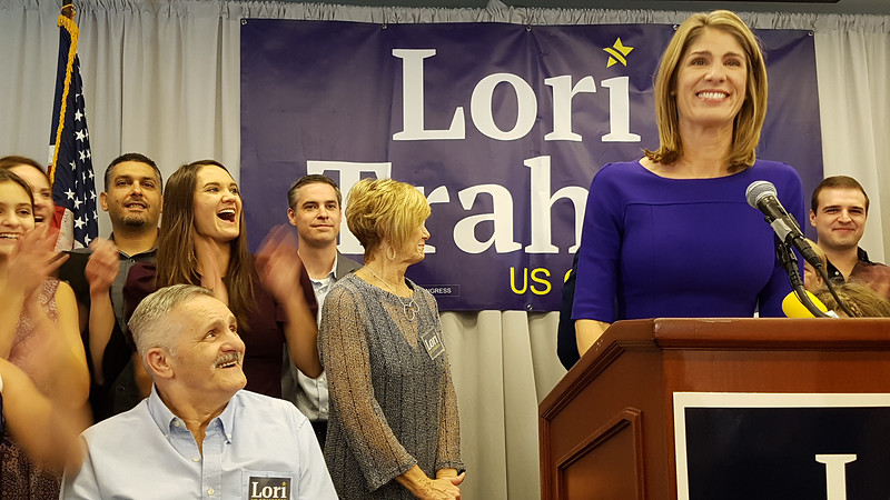 Lori Trahan wins 3rd Congressional District seat. Her father Tony Loureiro, front right, looks on as she greets supporters. (SUN/Julia Malakie)