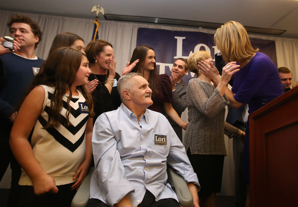 . Lori Trahan wins 3rd Congressional District seat. Lori Trahan greets her mother Linda Loureiro as her niece Ellie D\'Amico, 8, of Andover, left, father Tony Loureiro, and other family members look on. (SUN/Julia Malakie)