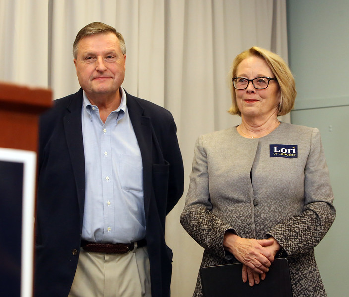 Predecessors in the Lowell area congressional seat, Chet Atkins and incumbent Niki Tsongas listen to Marty Meehan speak as Lori Trahan wins 3rd Congressional District seat. (SUN/Julia Malakie)
