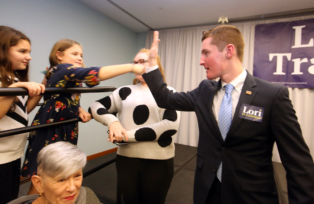 . Lori Trahan wins 3rd Congressional District seat.  From left, Trahan\'s niece Ellie D\'Amico, 8, of Andover, daughter Grace, 8, of Westford, family friend Irene Emerson, 12, of Lowell, and Methuen city councilor Ryan Hamilton, celebrating as they wait for Trahan to appear. (SUN/Julia Malakie)