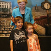 Sen. Elizabeth Warren poses for photos with Cole Perry, 8, and his sister with Lila Perry, 5, of Carlisle, after her town hall meeting at UTEC in Lowell. (SUN/Julia Malakie)