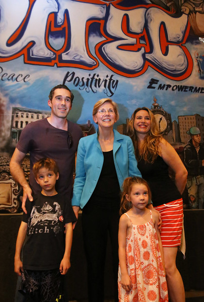 Sen. Elizabeth Warren poses for photos after her town hall meeting at UTEC in Lowell, with Ben and wife Jodie Perry of Carlisle and their kids Cole, 8, and Lila, 5. (SUN/Julia Malakie)
