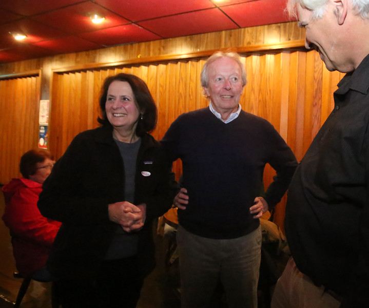 Lowell city councilor Edward Kennedy and supporters wait for election results in his state senate race, at Cappy's Copper Kettle. Edward Kennedy with his wife Susan, and Geoffrey Feldman of Lowell, right, who worked on the campaign. (SUN/Julia Malakie)