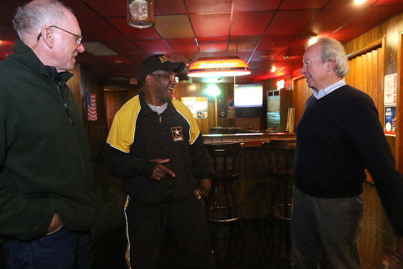 Lowell city councilor Edward Kennedy and supporters wait for election results in his state senate race, at Cappy's Copper Kettle. Kennedy, right, with Jack McWilliams of Lowell, left, and Harvey Robinson of Dracut, center. All three used to drive Lowell Sun delivery trucks when they were young. (SUN/Julia Malakie)
