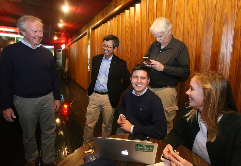 Lowell city councilor Edward Kennedy and supporters look at numbers his supporters were phoning in, in his state senate race, at Cappy's Copper Kettle. From left, Kennedy, Vesna Nuon, Phil Geoffroy of Chelmsford, Geoffrey Feldman of Lowell, and Meaghan Callahan of Boston (Phil's girlfriend). (SUN/Julia Malakie)