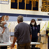 Littleton High School, the polling place this year. Voters Paul Biagioni, left front, and Steve Dunn, right, check in with poll volunteers Marilyn Converse, left, and Melissa Dunn (Steve's wife). JULIA MALAKIE/LOWELLSUN