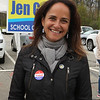 Candidates in Littleton town election stand outside Littleton High School, the polling place this year. Candidate for School Committee Jen Gold. JULIA MALAKIE/LOWELLSUN