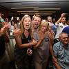 Lori Trahan supporters react to hearing she narrowly won the Massachusetts 3rd Congressional District Democratic primary. Family member include stepson Thomas Trahan, third from left, mother Linda Loureiro, aunt Audrey Ubele (behind Linda), father Tony Loureiro, and daughter Grace Trahan, 8.  (SUN/Julia Malakie)