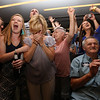 Lori Trahan supporters react to hearing she narrowly won the Massachusetts 3rd Congressional District Democratic primary. Family members include mother Linda Loureiro, third from left, aunt Audrey Ubele (behind Linda), and father Tony Loureiro, seated.  (SUN/Julia Malakie)