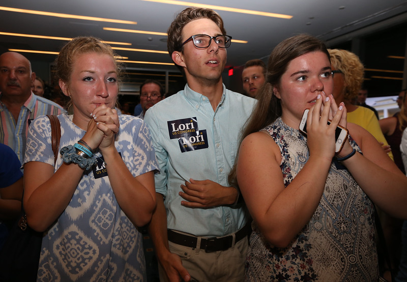 Lori Trahan party for Massachusetts 3rd Congressional District Democratic primary. Supporters are told that Trahan is less than 300 votes ahead of Koh. From left, Isabelle Cole, 17, of Chelmsford, Connor Pennell, 20, of Tewksbury, and Evie Hobbs, 22, of Lexington. [They were told actual  number, but I didn't catch it.] (SUN/Julia Malakie)