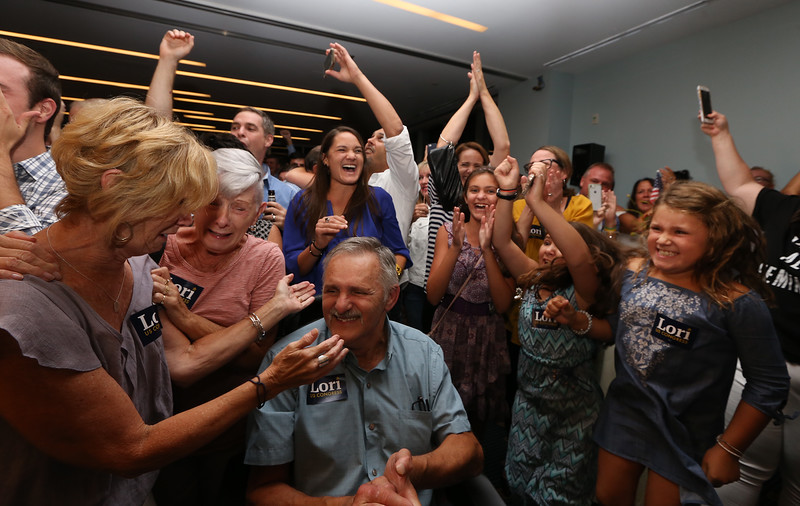 Lori Trahan's mother Linda Loureiro, left, aunt Audrey Ubele, father Tony Loureiro, and daughter Grace Trahan, 8, right, celebrate after hearing she narrowly won the Massachusetts 3rd Congressional District Democratic primary.  (SUN/Julia Malakie)
